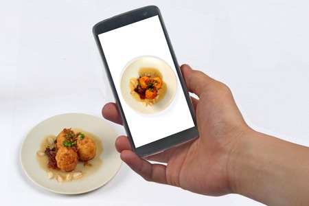 Take photo a dish of fried hard-boiled eggs with tamarind sauce call as Khai Luk Keoi in Thai ,which mean egg gift  from son-in-law ,for share to social network. Stock Photo