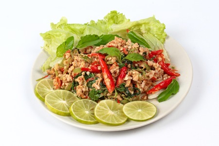 Fried spicy basil with minced pork topped sliced green lemon and and lettuce is top ten of popular Thai food.