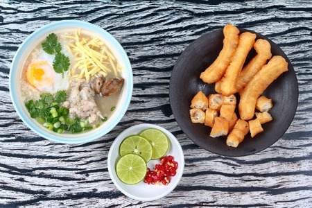mined: Rice porridge with mined pork and chicken lever served with side dish as Patongko (deep-fried dough stick) and spicy sour fillin.