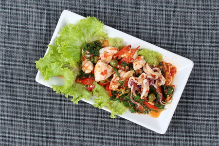 Fried spicy mixed herb  with squid .