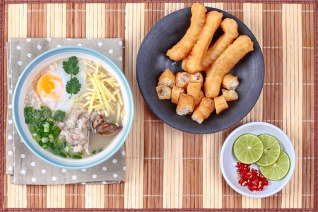 mined: Rice porridge with mined pork and chicken lever served with side dish as Patongko (deep-fried dough stick) and spicy sour filling.