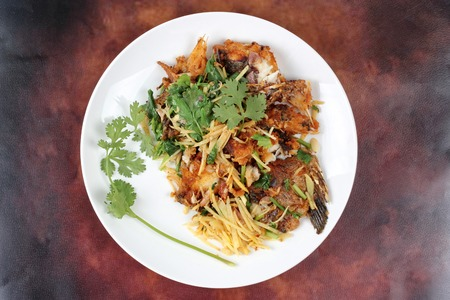 pla: Fried ginger with Tilapia fish  (Call Pla Nil Pad Khing in Thai) Stock Photo