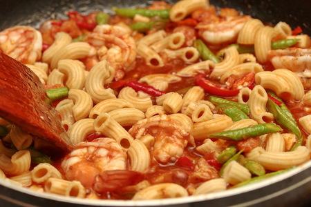 Hot cooking home made,fried macaroni with shrimp , call Pad Thai Macaroni in Thai .
