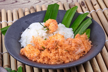 split up: Close up,Sticky rice in coconut milk with stir-fried grated coconut and shrimp Stock Photo