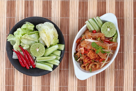 Spicy and sour mixed vegetable salad with pork skin and pork rind  served .