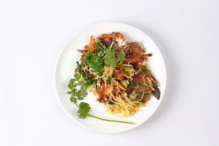 fishbone: Thai food,Fried ginger with Tilapia fish  (Call Pla Nil Pad Khing in Thai) topped coriander.