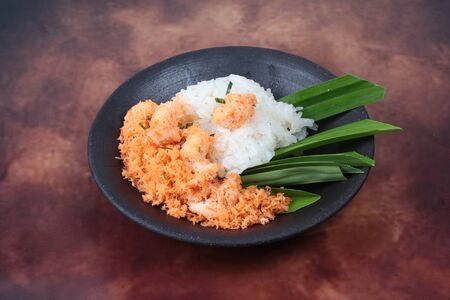 sesame street: Sticky rice in coconut milk with stir-fried grated coconut and shrimp is popular Thai dessert Stock Photo