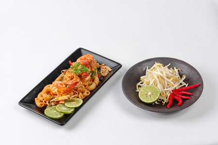 Thai fried macaroni with shrimp , call Pad Thai Macaroni in Thai, is interfood by using macaroni to cooked with Pad Thai as tamarind sauce,egg,minced roasted nut,green lemon,red hot chili pepper,bean sprouts,lentils,tofu and coriander.  Stock Photo