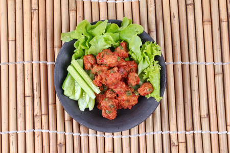 pla: Thai food,Deep fired curried fish cake with lentils served with side dish as cucumber ,red chili and red onion in sour sauce. (Tod Mun Pla Krai) is popular Thai dessert.
