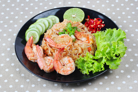 split up: Fried rice with shrimp call Khao Pad Kong in Thai is popular asia food s with  halved green lemon,sliced cucumber and lettuce.