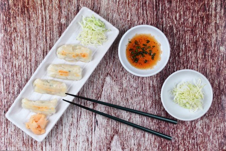 sesame street: Japanese steamed stuffing flour with pork and cabbage as Gyoza with side disk. Stock Photo