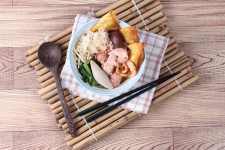thai noodle: Thai noodle with pink tofu soup topped rugby fishball,wonton,porkball,boiled porkblood,pork rind,coriander and white mushroom call  Yen Ta Fo in Thai Stock Photo