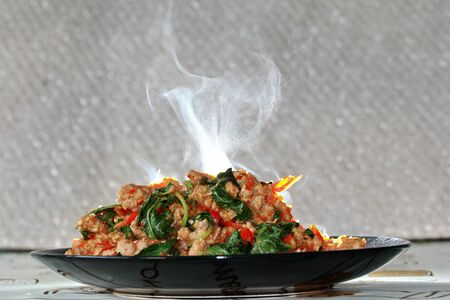 top ten: Aroma smell of  of fried spicy basil with minced pork topped  lettuce is top ten of popular Thai food.
