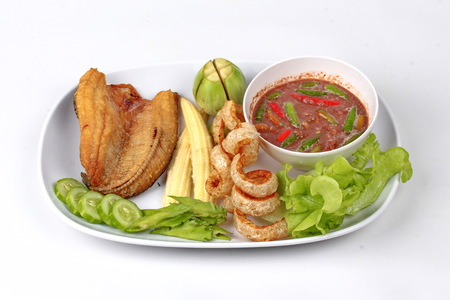striped snakehead fish: Ready served of Spicy shrimp paste dip as  Nam Prik Kapi in Thai with deep fired Sun-dried striped snakehead fish ,crispy pork rind ,lentils ,winged bean ,corn and sliced cucumber.