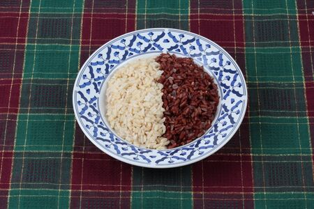 cleaned: Ready served of brown rice ,milled rice imperfectly cleaned and organic red brown jasmine (Manpoo) rice ,Popular Thai organice  for health care. Stock Photo