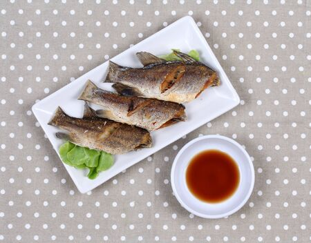 Thai food , Deep fried small snapper with bean sauce. Stock Photo