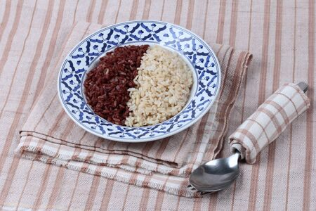Ready served of brown rice ,milled rice imperfectly cleaned and organic red brown jasmine (Manpoo) rice ,Popular Thai organice  for health care. Stock Photo