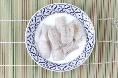 Thai dessert , Ready served cultivated banana in coconut milk call Klaui Boach Chee in Thai Stock Photo