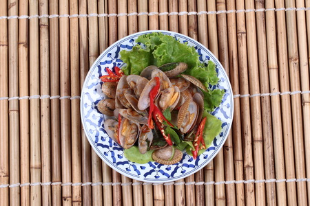 Thai food , Stir fried clams with roasted chile paste call Hoi Lai Pad Prik Phao. Stock Photo