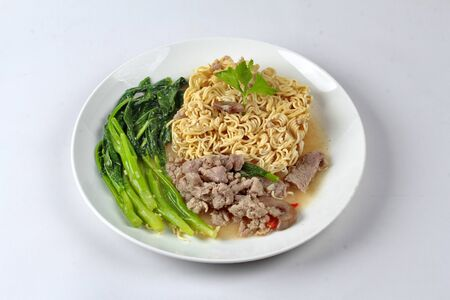 Asia food , Instant Yakisoba noodle topped kale soup with minced pork and pig spleen call Rad Naa Yakisoba.