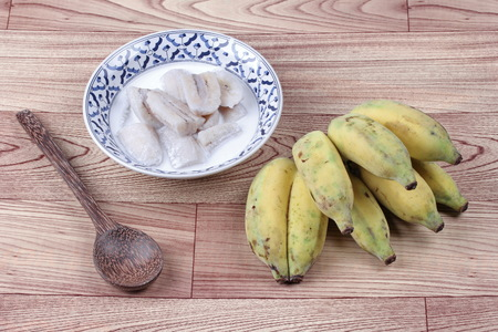 Thai dessert , Ready served of cultivated banana in coconut milk and wholes of banana.