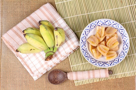 Thai dessert , Ready served of boiled banana in syrup and wholes of banana.