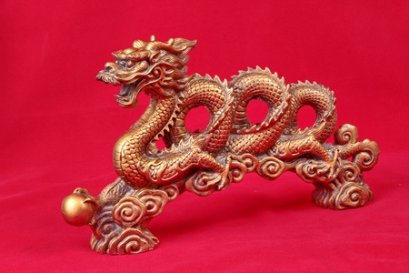 Golden dragon statue on red background, to celebrate the blessing. According to the beliefs of the in China. To give life and trade flourished. Stock Photo