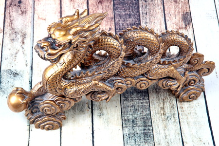 Golden dragon statue on wood, to celebrate the blessing. According to the beliefs of the in China. To give life and trade flourished.