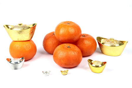 asian ancestry: Golden orange with silver and gold of silver ingots on white background, to celebrate the blessing. According to the beliefs of the in China. To give life and trade flourished.