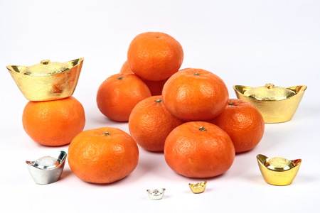 Golden orange with silver and gold of silver ingots on white background, to celebrate the blessing. According to the beliefs of the in China. To give life and trade flourished.