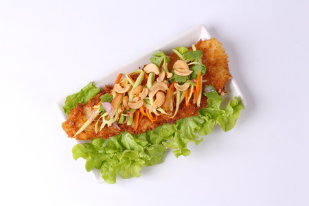 Spicy crispy deep-fried Dollys fish salad with roll green mango call Dolly Yum Mamoung.