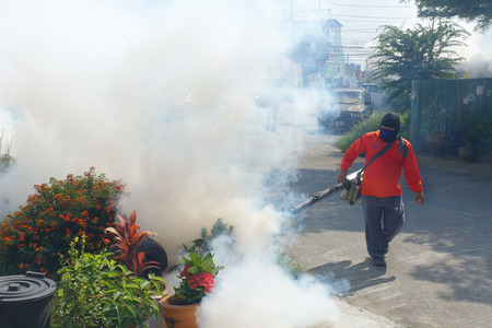 mosquitoes: Officers are being injected smoke removal substance mosquitoes sprayer and  larvae. To prevent the spread of disease from mosquitoes.