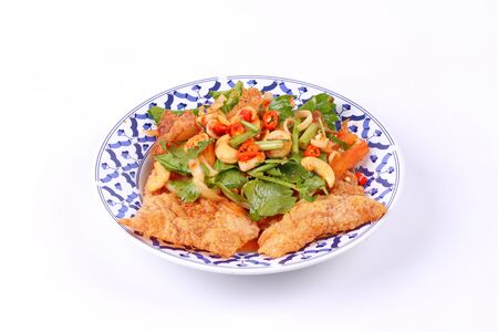 pla: Thai cuisine, Spicy and sour mixed vegetable salad with crispy pork served ,call Pla Moo Phan in Thai. Stock Photo