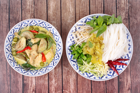Popular Thai food, Rice noodle and green chicken curry in coconut milk call Kha Nom Jeen Kaeng Kai in Thai served on Thai Pattern dish.