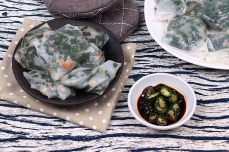 Chinese dessert, Steamed Dumpling stuffed with fried garlic chives ,dried shrime and mined pork  served with spicy soy source, Kuicheai. Stock Photo