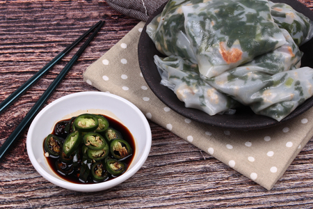 mined: Chinese dessert, Steamed Dumpling stuffed with fried garlic chives ,dried shrime and mined pork  served with spicy soy source, Kuicheai. Stock Photo