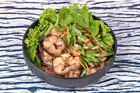 catfish: Thai cuisine , Spicy fried cowpea and basil with sliced catfish call Pad Ped Pla Duk in Thai on Korean black plate