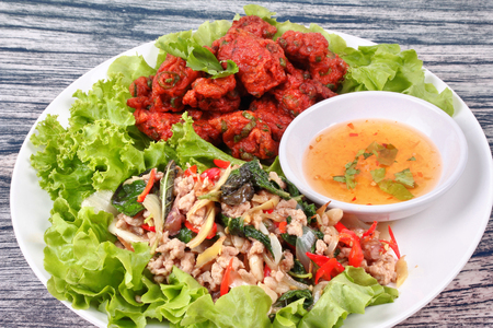 Thai recipe ,Fried spicy basil with minced pork served  with curried fish cake are top ten of popular Thai food.