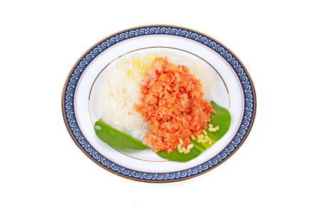 sesame street: Thai dessert ,Sticky rice in coconut milk with stir-fried grated coconut and shrimp served topped coconut milk on Thai pattern disk