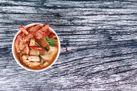 Popular Thai recipe ,Tom Yum fresh prawn with milk and sliced coconut. Thai Spicy and sour prawn soup  call Tom Yum Kung Num Khon in Thai as mixed herb in soup with coconut milk . Have text space on right.
