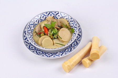 Thai recipe, Green chicken curry in coconut milk with soft bamboo pole shoot  and  ready served of soft bamboo pole shoots.