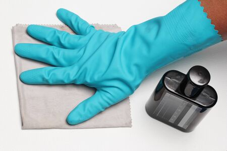 formica: Wear rubber gloves and rubbed clean leather products by chemical polishing with a microfiber cloth. Stock Photo