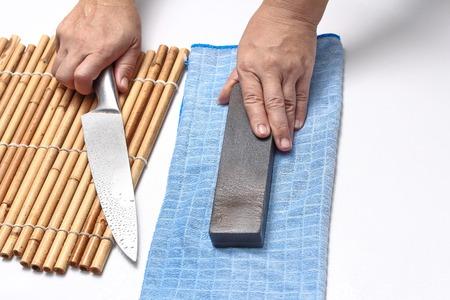 自家製、スプレー水と砥石で包丁を研ぐためにメイド。 写真素材