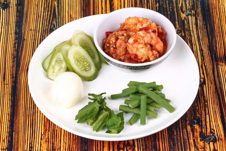 Thai Popular cuisine, Fresh shrimp chili dip as Nam Prik Kung Sod  in Thai and boiled egg,green bean ,winged bean and cucumber.