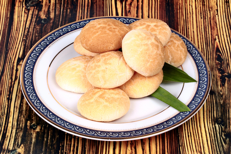 flavored: Thai sweet soft biscuit,Thai sweetmeat made of roasted flour, egg and sugar call Khanom Ping in Thai. Stock Photo