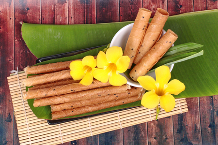 sesame street: Thai popular dessert,Gold candy rolls ,Thai sweetmeat made of flour, coconut milk and egg call Tong Muan in Thai.