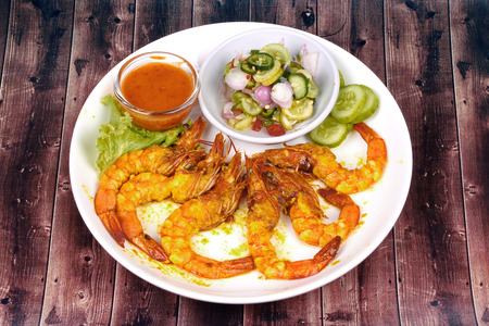 peanut sauce: Charcoal boiled prawn satay, homemade, served with cucumber chili sauce as Ar Jad in Thai and nut sauce are popular Asia cuisine.