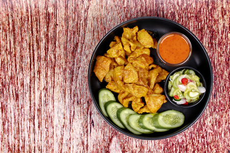 Charcoal boiled pork satay, homemade, served with cucumber chili sauce as Ar Jad in Thai and nut sauce are popular Asia cuisine. Stock Photo