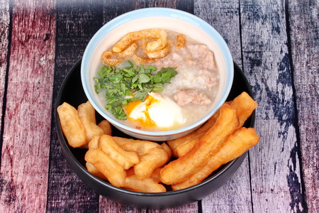 mined: Rice porridge with mined pork and boiled egg served with Patongko ,deep-fried dough stick. Stock Photo