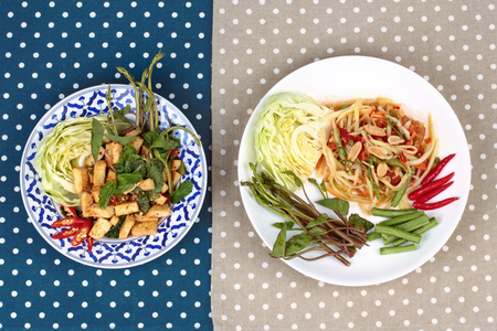 Spicy papaya salad and Spicy sour mixed herb salad with fried tofu for Chinese vegetable festival .